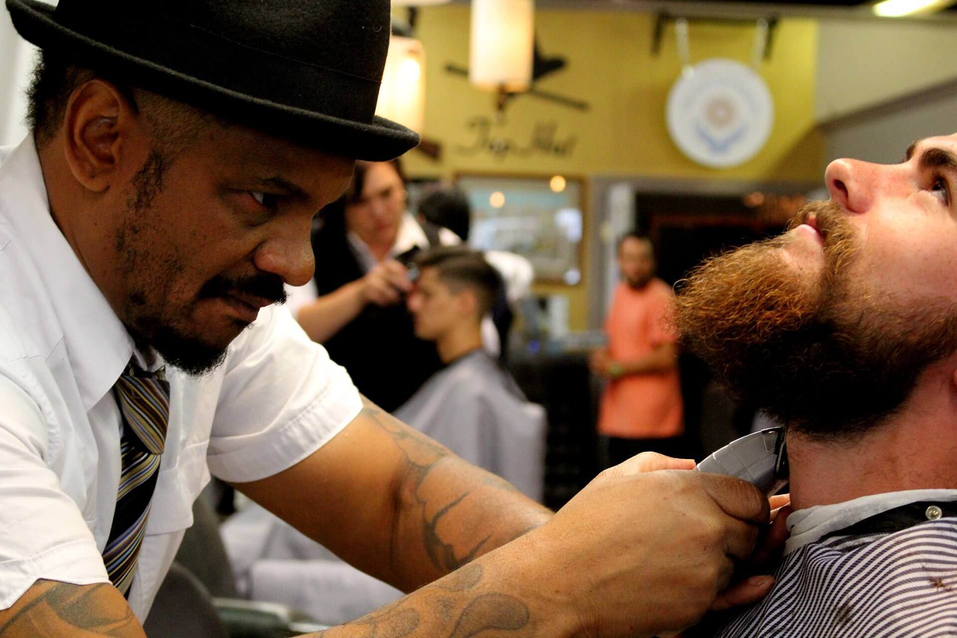 Photo of barber shaving with clippers